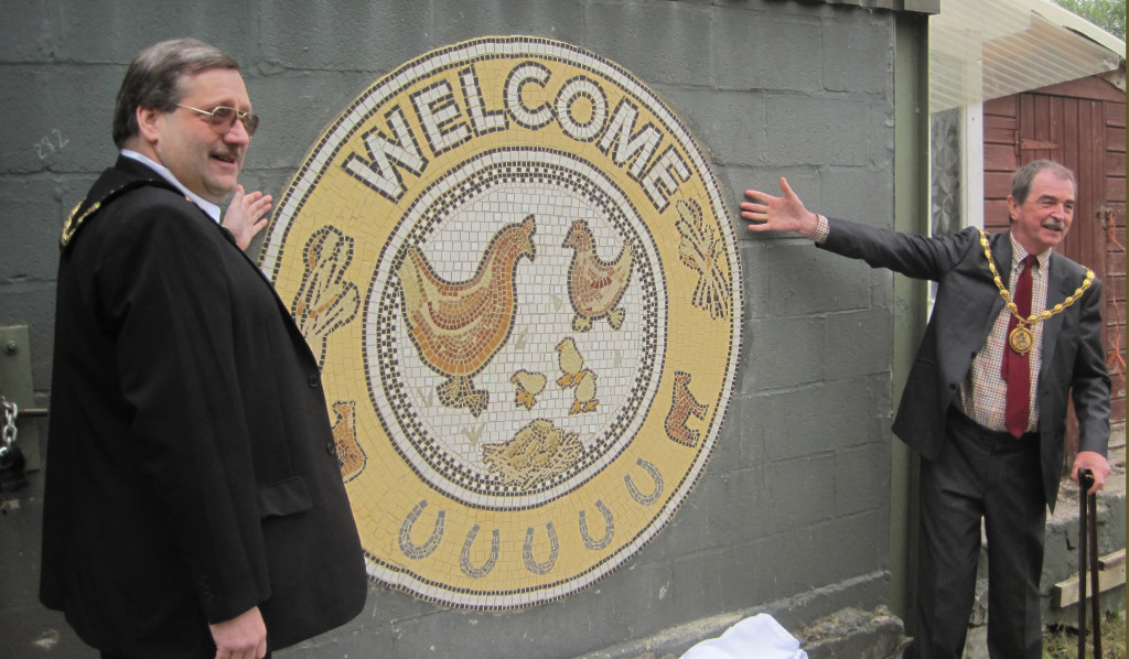 The Chair of Derbyshire County Council and the High Peak Mayor unveil the Mosaic sign.