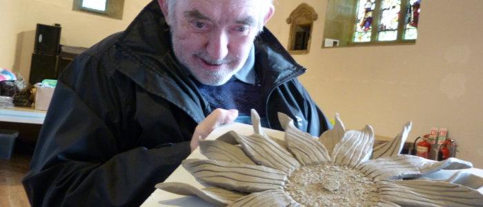 Older man looking at an art piece