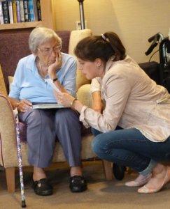 Bella Hardy reading to elderly lady