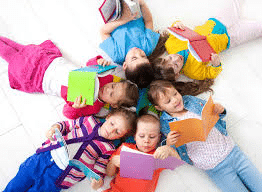 kids reading lying in a circle